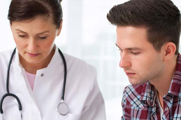 a woman doctor discuss with a man patient