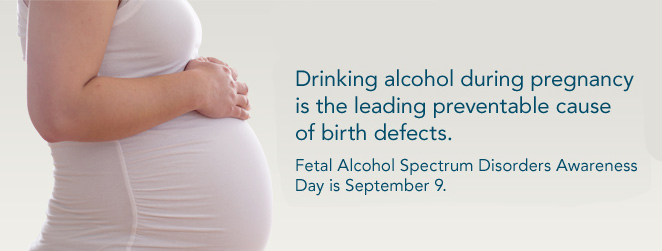 "A pregnant woman clasps her stomach.  The caption reads: ""Drinking alcohol during pregnancy is the leading preventable cause of birth defects. Fetal Alcohol Spectrum Disorders Awareness Day is September 9."""