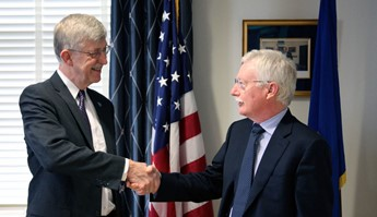 Photo showing N.I.H. Director Francis Collins shakes hands with Dr. George Koob