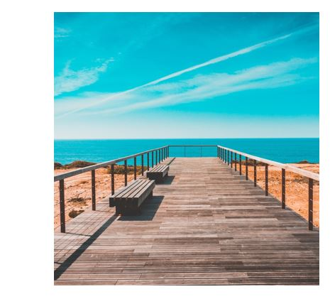 View of a beach boardwalk and summer sky