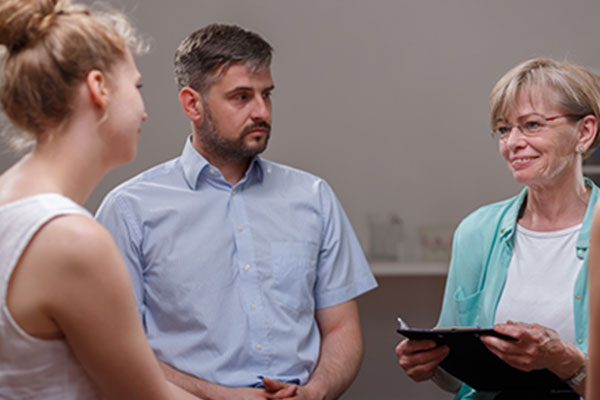 family talking to practitioner