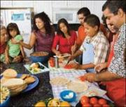 Image of hispanic family preparing dinner