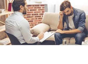 man sitting in a psychiatrist office