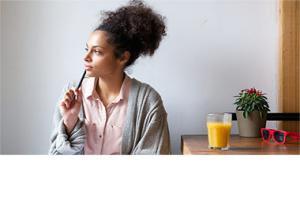 woman sitting at table thinking