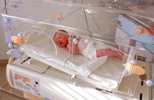 Photo of infant in incubator
