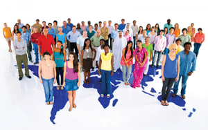 Image of large group of people standing on world map