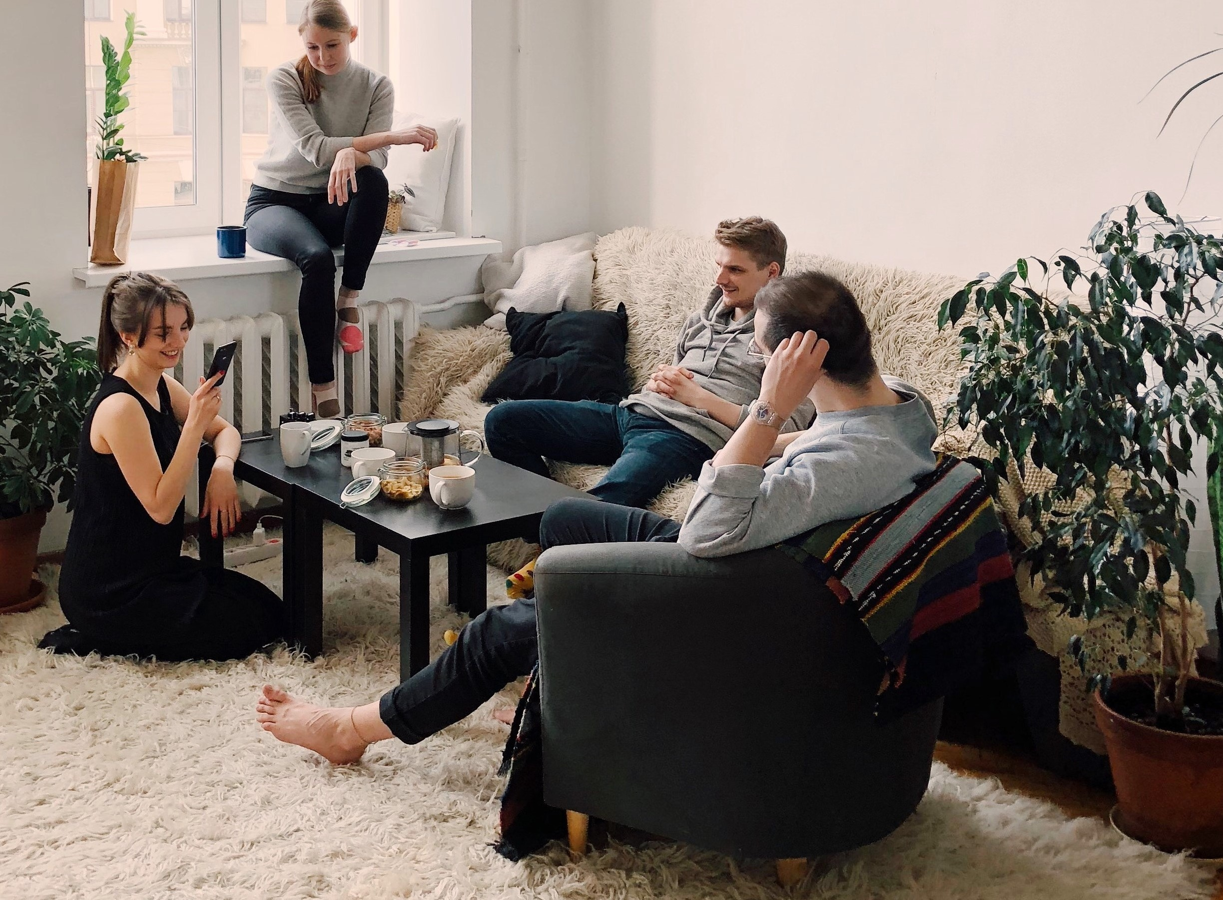 Young people hanging out in a living room